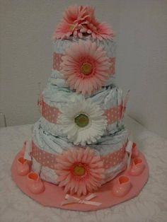 Check out this item in my Etsy shop https://www.etsy.com/listing/223670111/baby-girl-gerber-daisy-diaper-cake-baby
