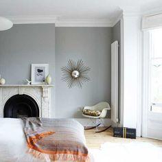 gray paint, marble fireplace, eames rocker, light fixture