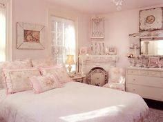 Pink is the most popular color in the shabby chic decorating palette. When it comes to fabrics, dainty rose prints are the go-to choice. The two favorites come together in this soft and romantic master bedroom by RMS user vintagerosecollection.
