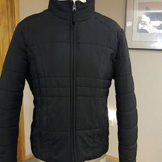 Athletic Works Black Puffer Coat Black size large coat. Not real heavy and all aspects of the coat is polyester. Two front pockets. Athletic Works Jackets & Coats