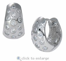 Ziamond Cubic Zirconia Huggie Hoop Earrings in 14K White Gold.  The Burnish Set Huggie Earrings are also available in 14k yellow gold and set with the finest hand cut cubic zirconia. $695 #ziamond #cubiczirconia #cz #huggie #earrings #hoops #14kgold