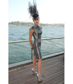 At the Istancool Festival in an unforgettable hat and silver dress.   - HarpersBAZAAR.com