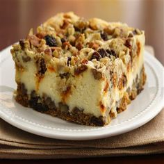 Oatmeal Raisin Cheesecake Crumble - oatmeal raisin cookie dough forms the crust of this delicious cheesecake with a crumble top made with cinnamon chips, raisins, oats, and pecans. | #decadent #cheesecake