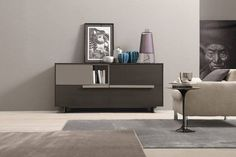 """This Storage Unit having a Combination of Light Grey & Dark Grey with Linear Handles is ✨ Looking Super Stylist. Single Seater Upholstered Sofa with Metal Circular Side Table Giving a """"ME TIME"""" Space to the User - Gharpedia Living Room Wall Units, Living Room Modern, Living Room Designs, Bedroom Furniture Design, Living Room Furniture, Furniture Ideas, Modern Buffet Table, Sideboards For Sale, Wall Unit Designs"""