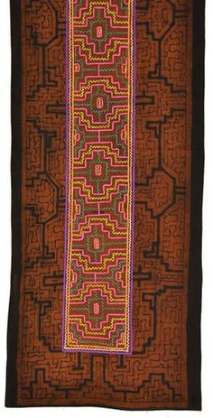 Designs combining earthen clay slip and colorful embroidery are distinctive to the Shipibo women of the Amazon basin and are used expertly in this table runner.