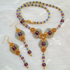 Micro Macrame Necklace and Earrings by KnotGypsyDesigns. http://www.etsy.com/listing/62136537/micro-macrame-pattern-fans-necklace-and?ref=sr_gallery_9_includes%5B0%5D=tags_search_query=macrame+tutorial_page=2_search_type=all_facet=macrame+tutorial_view_type=gallery