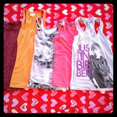 BUNDLE OF 5 tank tops We have a burgundy sleeveless burn out  size MEDIUM FOREVER 21, the orange with yellow bow racer back size MEDIUM HOLLISTER, grey pink turquoise tank top size SMALL MOSSIMO, pink racer back v neck size MEDIUM FOREVER 21, and a grey Justin Bieber racer back size SMALL BRAVADO. All for one price.  Tops Tank Tops
