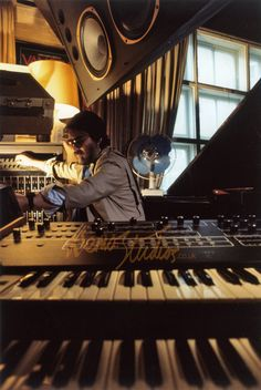 Vangelis working on scoring Blade Runner.  Evangelos Odysseas Papapthanassiou is his full given name.