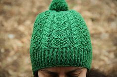 This sampler hat is chock full of beautiful Aran patterns, so you can try your hand at a variety of stitches and techniques in a small space. The interplay of patterns evokes the lush rolling hills and patchwork farmlands around Ireland's Rock of Cashel. Choose a bold or neutral color to show off the beautiful textures in this pattern.