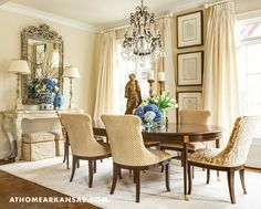 Neutral Dining Room with crystal chandelier, ornate mirror, polished wood dining table, via @sarahsarna.