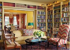 Library. Interior Designer: Elizabeth Brosnan Hourihan. Settee: From client's collection, refinished by Master Finishing & Restoration, Inc., upholstered in Old World Weavers damask fabric. Lolling Chair: From client's collection, reupholstered in Lee Jofa flame-stitch velvet. Cocktail table: The Farm Antiques, English Hunt scene papiere mache tray on stand, circa 1850.