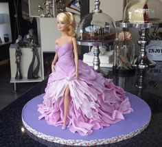 My very first attempt at a barbie cake with the help of an online tutorial I purchased!! Had so much fun and was extremely happy with the end result!! I love my new hobby!!