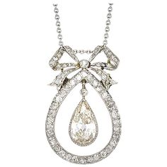 Pear cut diamond pendant with bow motif | From a unique collection of vintage brooches at https://www.1stdibs.com/jewelry/brooches/brooches/