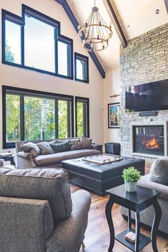 Cathedral ceilings in family room with stone fireplace make this a cosy space to relax. French Country Fireplace, Three Season Room, Living Room Styles, Comfortable Living Rooms, Storey Homes, Living Room With Fireplace, House And Home Magazine, House In The Woods, Great Rooms