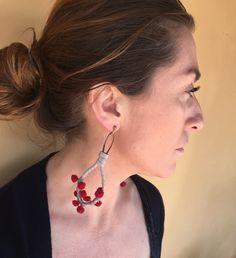 Pom poms earrings by WispaCollezioni