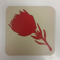Spiekeries cream coasters with red protea
