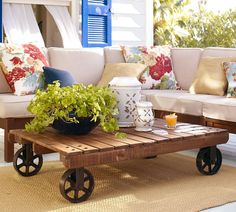 Love this coffee table  I bet I could make one myself, just have to find the right wheels.