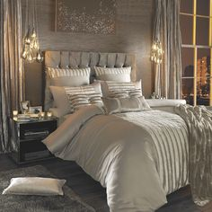 Kylie Minogue at Home - Lucette Praline bedding.  I totally want to make a painted canvas with sequins (as pictured above the bed).