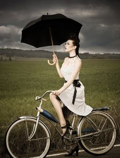 Girl on bike. Love this!  The dress the umbrella the bike. Everything!