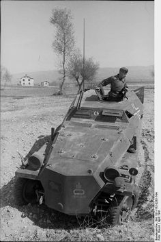 Bulgaria - Soldier (with lion symbol on cap and sleeves on light armored personnel carrier (Sd.Kfz 253) on the ground