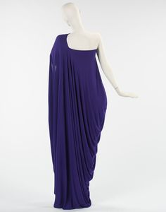 Evening Dress Halston 1975 Beginning his career as a milliner, Halston later crossed over to ready-to-wear clothing, promoting minimal design. His loyal clientele of the rich and famous chose to display his creations in trendy locales such as New...