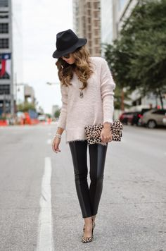 Outfit inspiration - sleek faux leather leggings, oversize sweater, wide-brim hat, leopard clutch and heels.