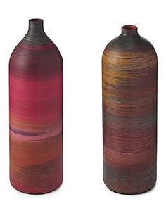 Recycled fire extinguishers are used to create these vases. Hand painted. voguevert