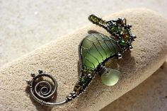 Wire Wrapped Seaglass seahorse pendant. Beautiful.