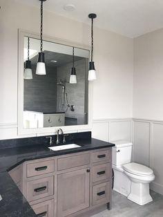 Farmhouse bathroom, board and batten wainscot painted Benjamin Moore Revere Pewter. Corner vanity with wall cabinet. Pendant lights. #bathroomremodel #bathroomideas #bathroomdesign
