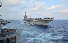 The U.S. Navy's forward-deployed aircraft carrier USS George Washington (CVN 73) steams towards the Military Sealift Command dry cargo and ammunition ship USNS Charles Drew (T-AKE 10) prior to a replenishment-at-sea. (U.S. Navy photo by Mass Communication Specialist 3rd Class Brian H. Abel/RELEASED)