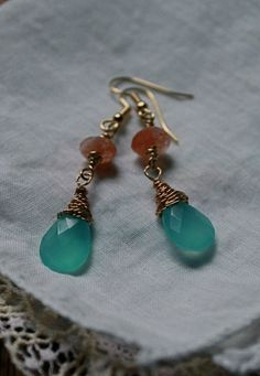 Check out this item in my Etsy shop https://www.etsy.com/listing/204787296/blue-chalcedony-and-sunstone-gold-dangle