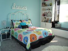 girls bedroom with built in book shelves and seat
