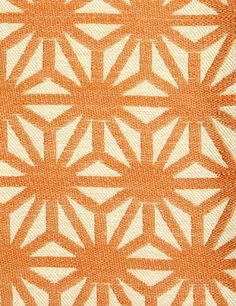 Starburst Woven Fabric A woven cloth with a geometric design in orange and off white.