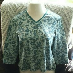 Lovely casual shirt in palette of blues and gold Pullover v-neck knit shirt with three quarter sleeves and a sweet, leafy print. 96% cotton and 4% spandex so the shirt has some stretch. Excellent used condition. Croft & Barrow Tops Crop Tops