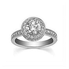 Engagement Ring with 0.648 CT. T.W. side diamonds, Round Shape