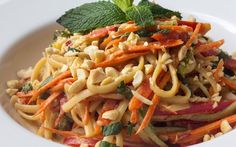 This noodle entrée features tons of red bell pepper, cucumber, carrot, radish, and scallion in a delicious peanut sauce.