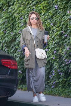 Jessica Alba wearing Proenza Schouler Ps1 Pouch in White, The Great. Knotted Tee Dress, Smythe Oversized Army Jacket, Ralph Lauren Gold Soft Ricky Bag and Ralph Lauren Gold Suitcase