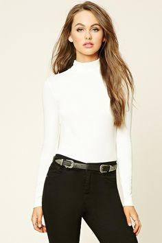 A ribbed knit top featuring a turtleneck and long sleeves.