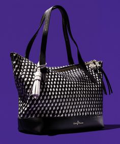 Woven bags aren't just for warm weather anymore. Use this tote from Cole Haan to carry your essentials well beyond Fall