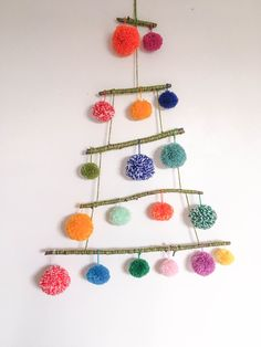 The Pom Pom Tree The Pom Pom Tree,Weihnachten pom-pom-tree-colourful-yarn-sticks-alternative-christmas Christmas Craft Projects, Craft Projects For Kids, Holiday Crafts, Spring Crafts, Craft Ideas, Recycled Christmas Tree, Handmade Christmas, Christmas Crafts, Christmas Movies