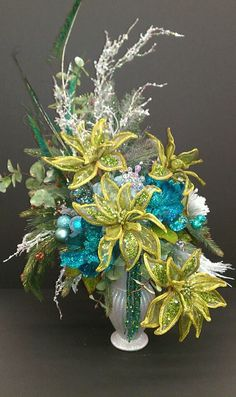 Christmas arrangement done in teals & lime green poinsettias~