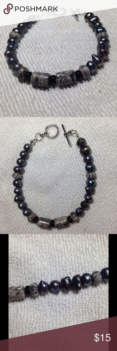 Black Pearl and Jasper Bracelet This bracelet is made with beautiful freshwater pearls and wave jasper. The pearls are a lovely dark shade and have a brilliant shimmer. This piece measures about 8 inches long including the toggle clasp. PeaceFrog Jewelry Bracelets