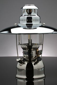 BriteLyt XL Nickel Plated Brass Lantern The only Multi-Fuel lantern made today. This package you can Light,Heat and Cook all with one lantern. A perfect companion for your outdoor lifestyle.