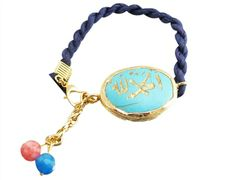 Our Blue Silk Allah Arabic Muslim Charm Bracelet will make the perfect addition to your Islamic bracelet collection! Beautifully rolled blue silk will encircle and adorn your wrist, giving great contrast to the colorful turquoise color stone charms.  Price: $39.99 #allahjewelry #allahbracelet #islamicbracelet #muslimjewelry #allahcharmbracelet #arabicbracelet #arabicjewelry