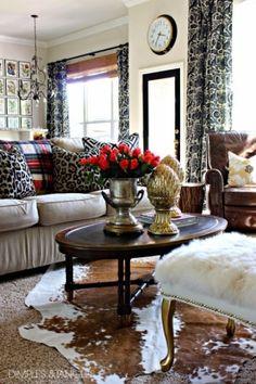 cowhide rug ... leopard pillows ... tartan throw