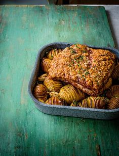 This beauty was the cover recipe for our March 2020 issue. Slow-roasted pork, crispy roasties, and a quick gremolata for a splash of colour.it's got Sunday written all over it Pork Belly Recipes, Roast Recipes, Pork Recipes, Cooking Recipes, Yummy Recipes, Dinner Recipes, Best Roast Recipe, Hasselback Potatoes, Good Roasts