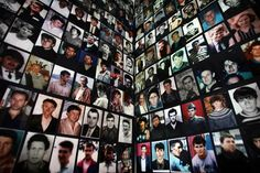 Portraits of Bosnian Muslims, victims of the 1995 Srebrenica massacre, are pasted on the wall in a room where survivors gathered in the Bosnian town of Tuzla in July 7, 2005.