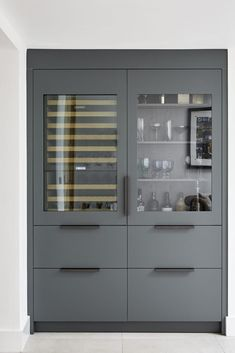 The Manhattan kitchen is the one with a New York feel; framed and hand-painted in Farrow & Ball's iconic Downpipe, with raw concrete worktops. Kitchen Pantry Design, Kitchen Display, Home Decor Kitchen, Kitchen Interior, Kitchen Units, Farrow Ball, Modern Drinks Cabinet, Manhattan Kitchen, Larder Unit