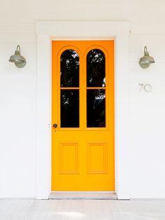 Orange door with symmetrical lights and oversized arch windows. I'm really into orange door. Orange Front Doors, Yellow Doors, Front Door Colors, Bright Front Doors, The Doors, Entrance Doors, Door Entryway, Entrance Ideas, Doorway