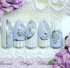 Gorgeous lilac nails with a silver damask